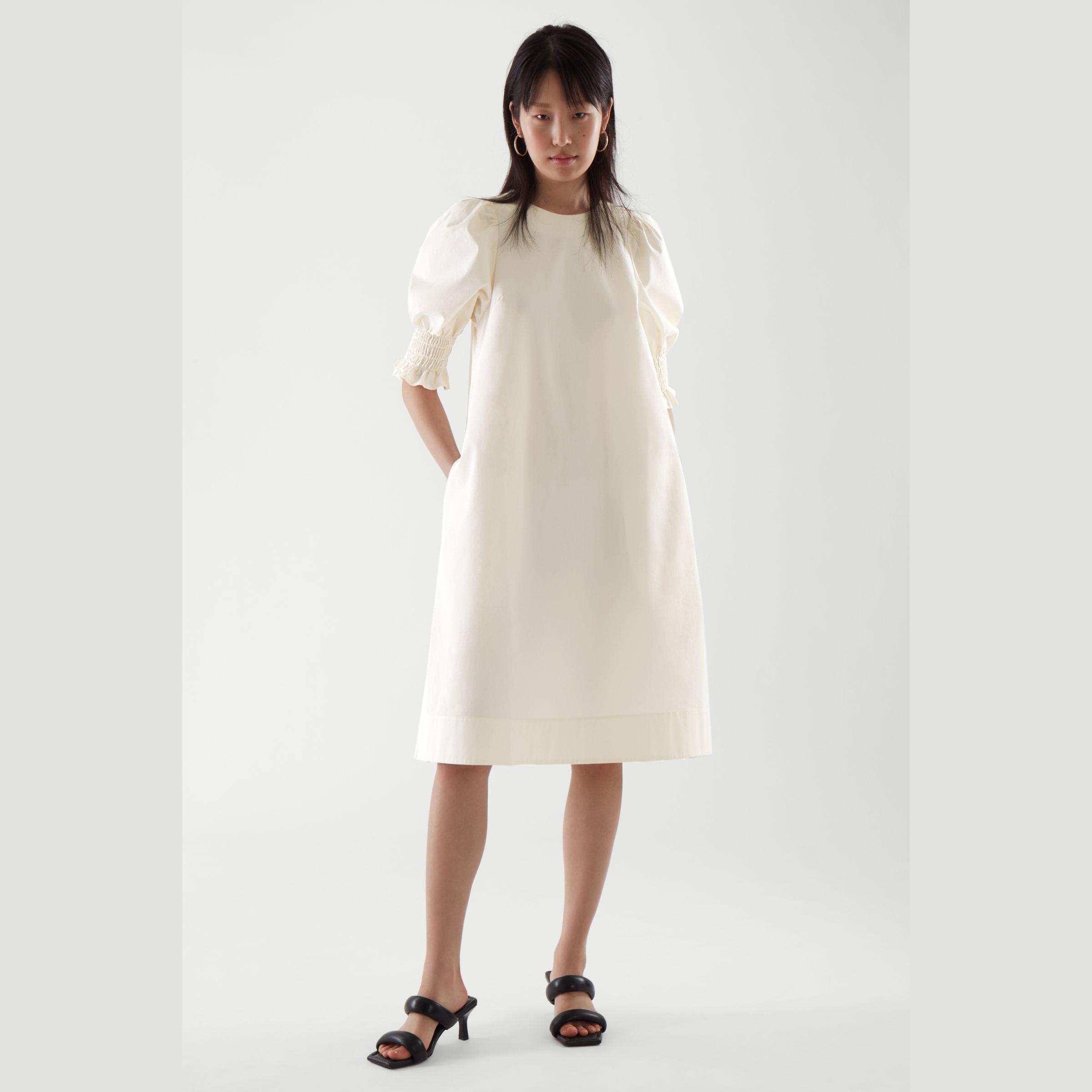 COS 泡泡袖奶油色长裙 8折