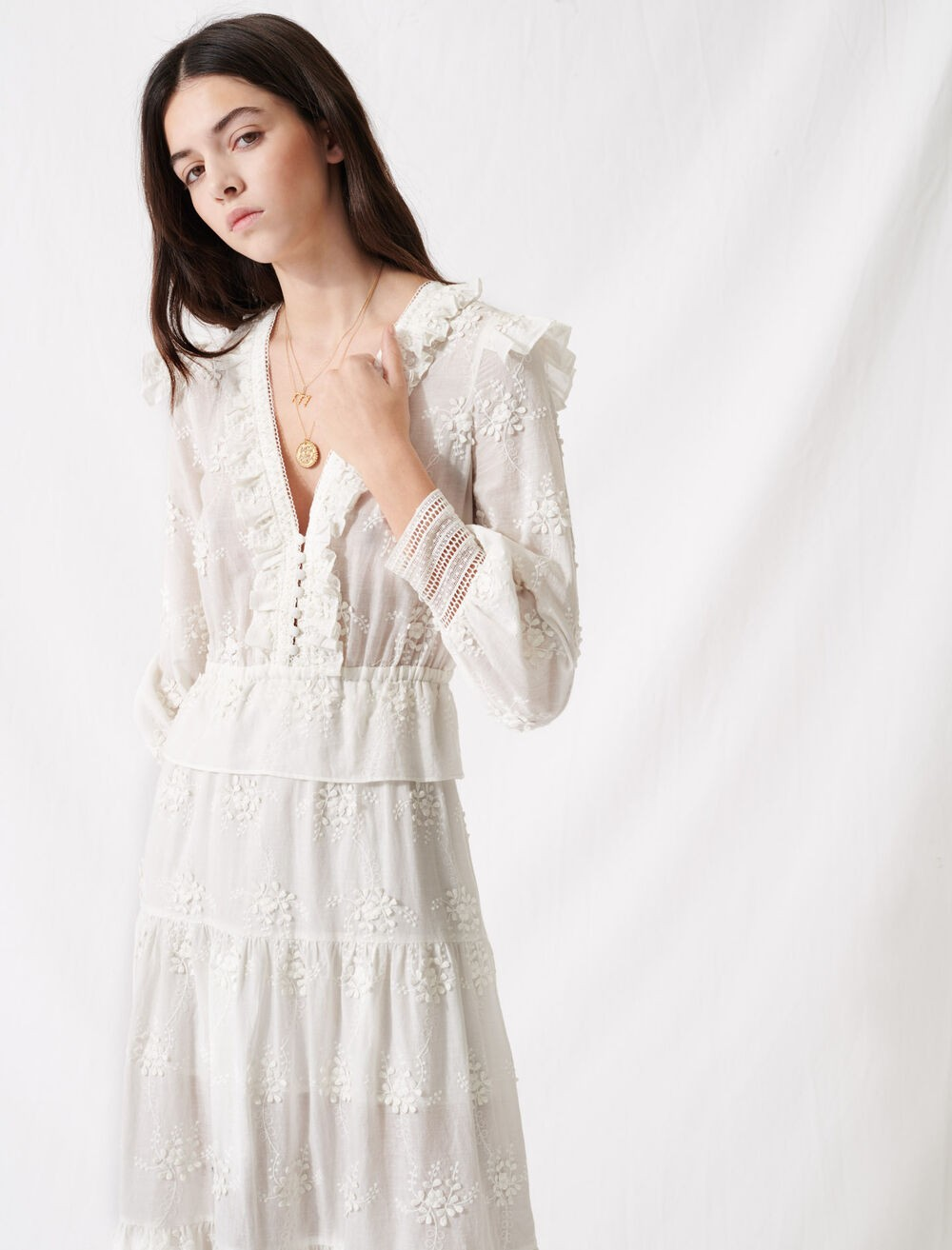 ecru dress with ruffles and embroidery
