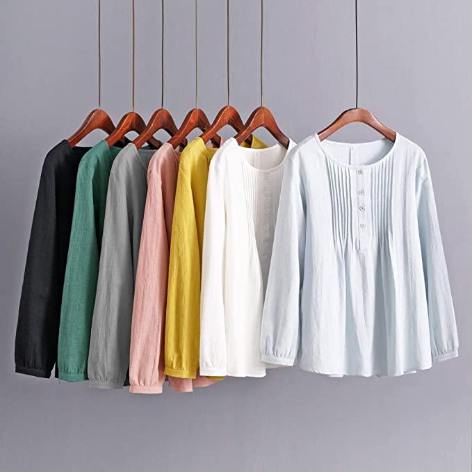 越简单的穿搭越出彩,有品位的女人都有一件棉麻衫